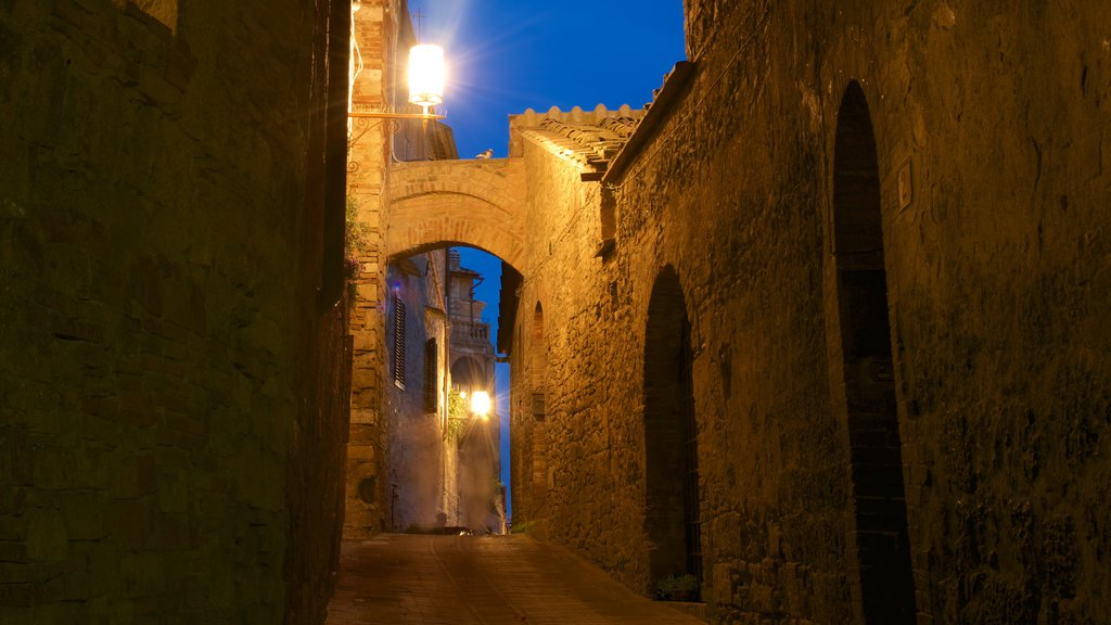 San Gimignano featuring a small town or village, night scenes and heritage architecture