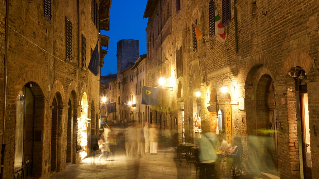 San Gimignano which includes cafe scenes, a small town or village and dining out