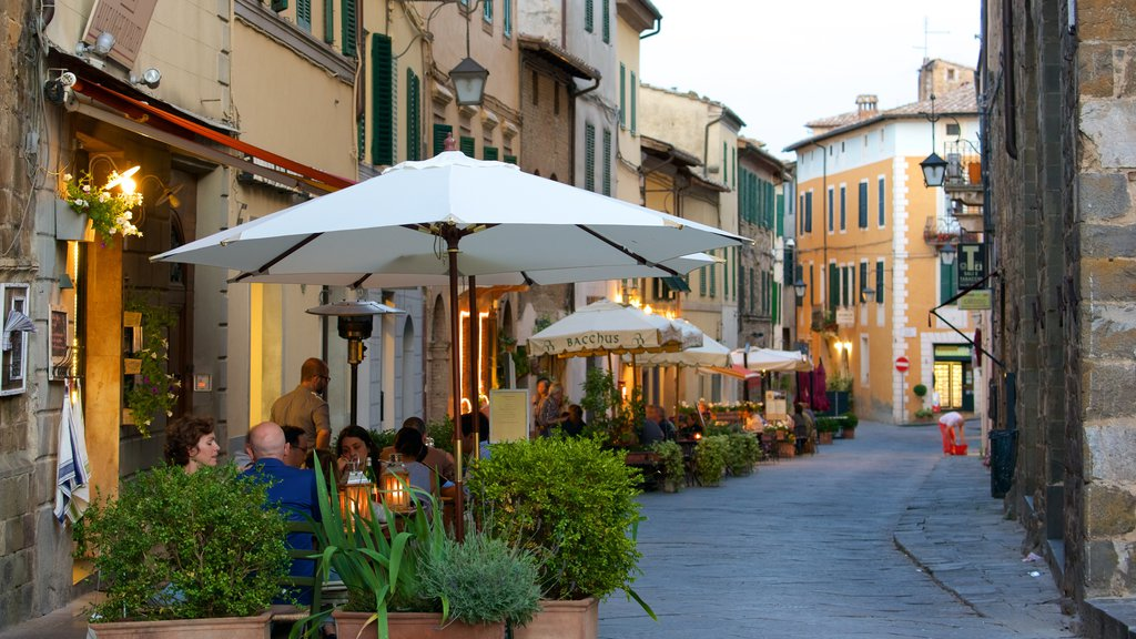 Montalcino showing dining out, a small town or village and street scenes