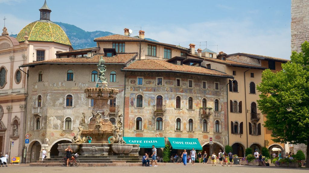 Trento showing a city, heritage architecture and a statue or sculpture