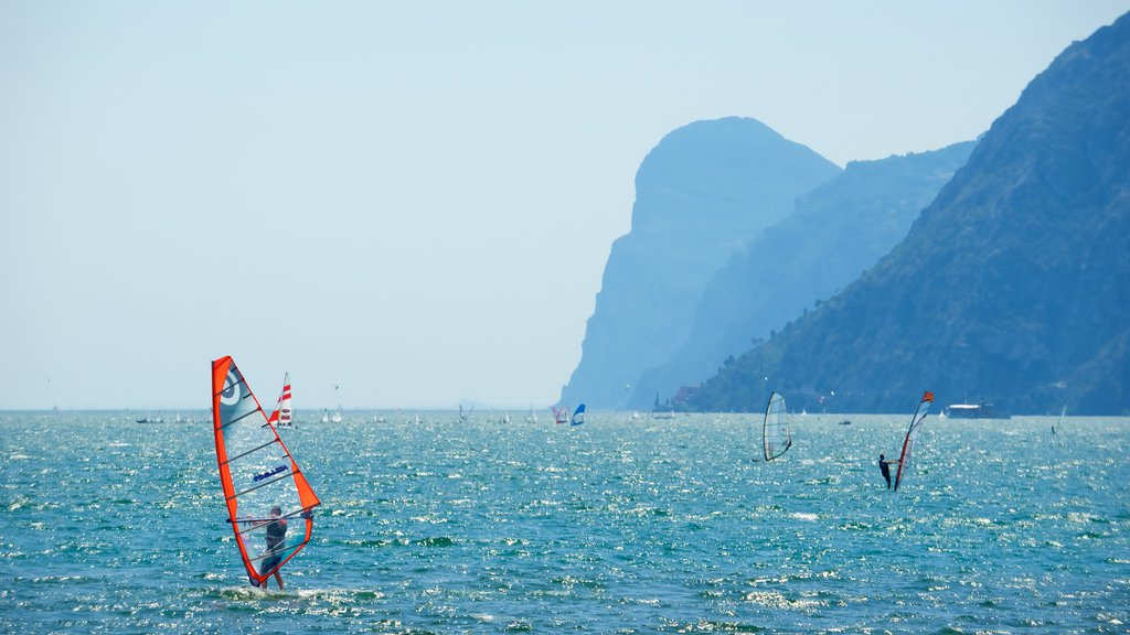 Nago-Torbole which includes general coastal views, mountains and windsurfing