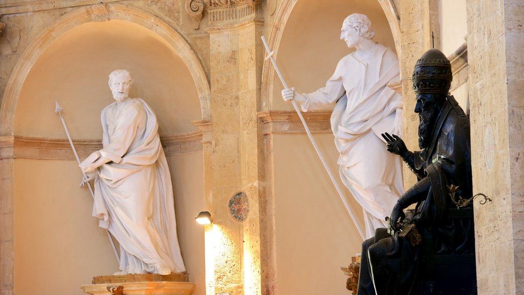 Santa Maria della Consolazione which includes religious elements, a statue or sculpture and a church or cathedral