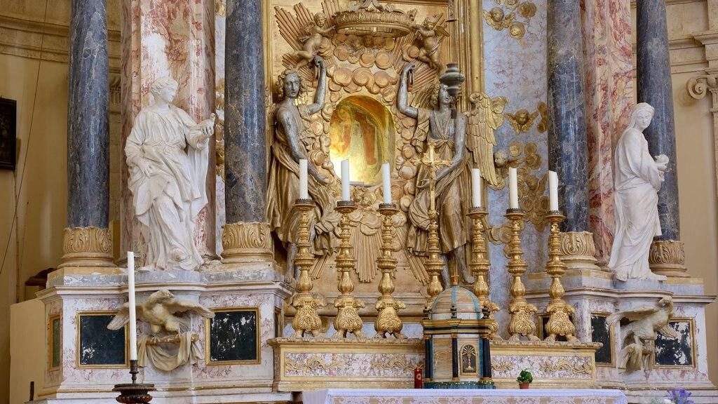 Santa Maria della Consolazione which includes a church or cathedral, a statue or sculpture and religious aspects