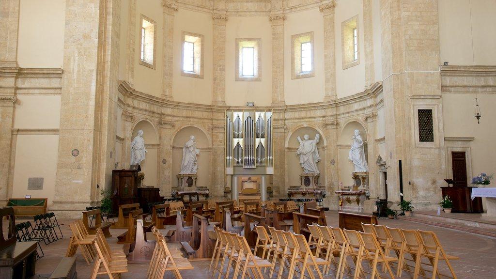 Santa Maria della Consolazione which includes a church or cathedral, interior views and a statue or sculpture