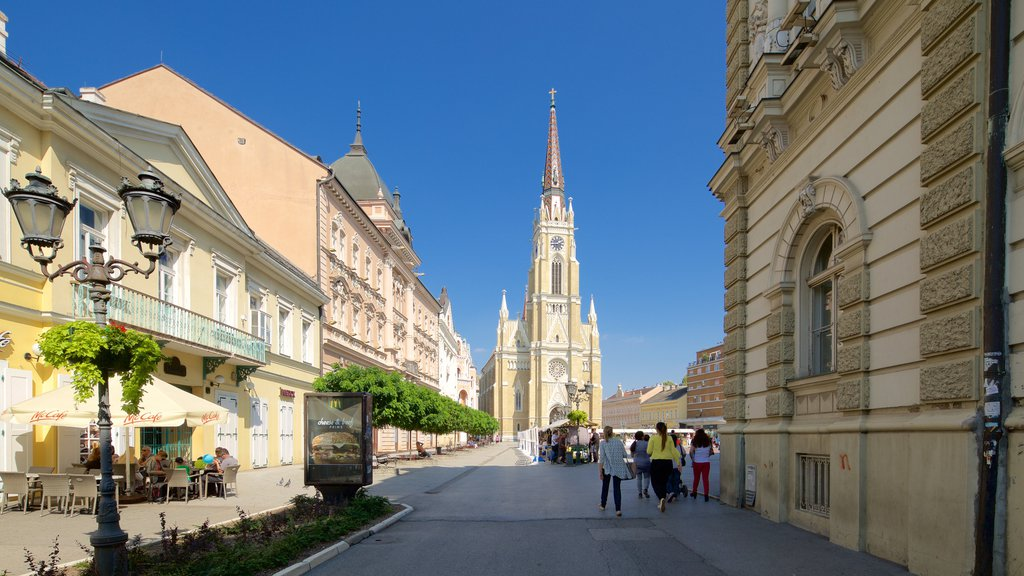 Church of the Virgin Mary featuring heritage architecture and street scenes as well as a small group of people