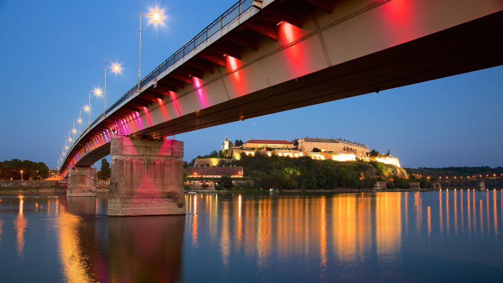 Petrovaradin Fortress showing a river or creek, a bridge and night scenes