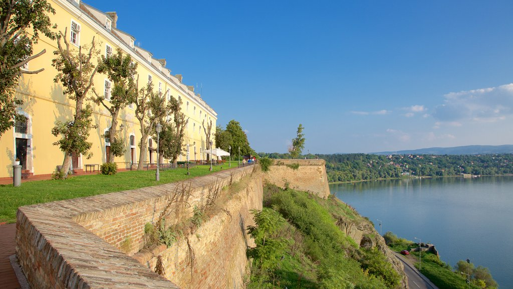 Petrovaradin Fortress featuring a river or creek and heritage architecture