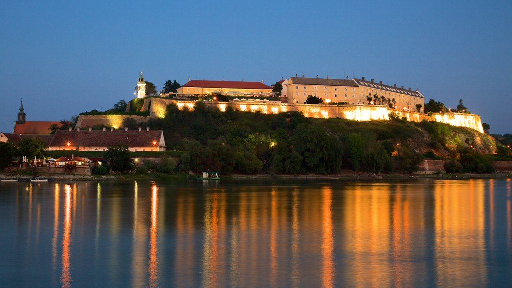 Petrovaradin Fortress featuring night scenes and a river or creek
