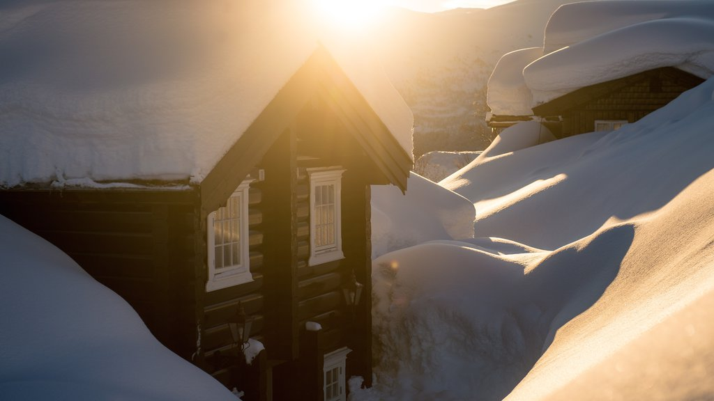 Myrkdalen which includes a small town or village, a sunset and snow