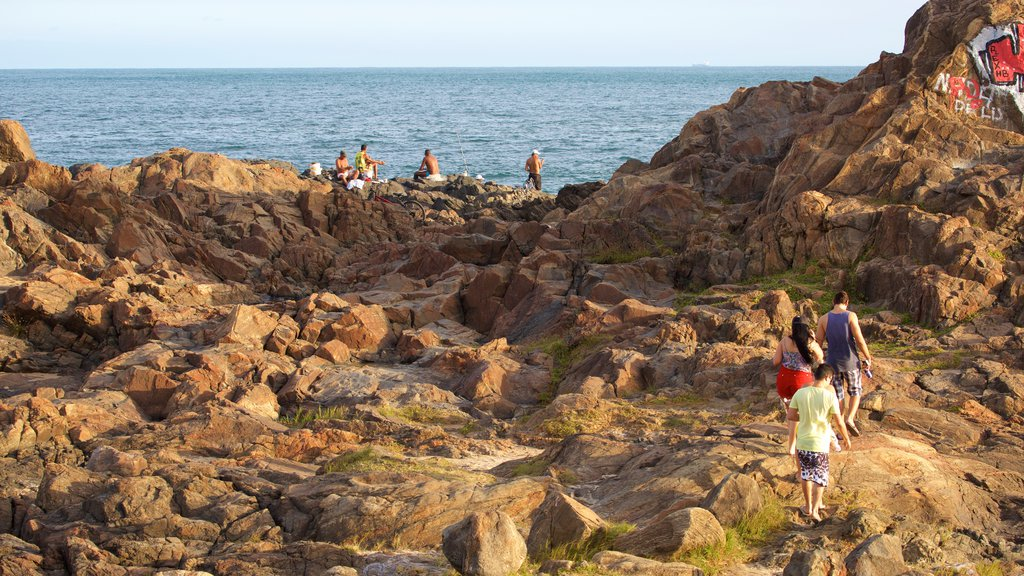 Farol da Barra Beach which includes general coastal views as well as a small group of people