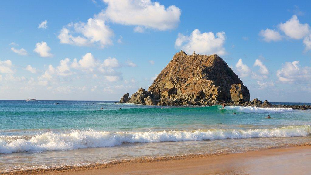 Conceicao Beach which includes surf, a sandy beach and general coastal views