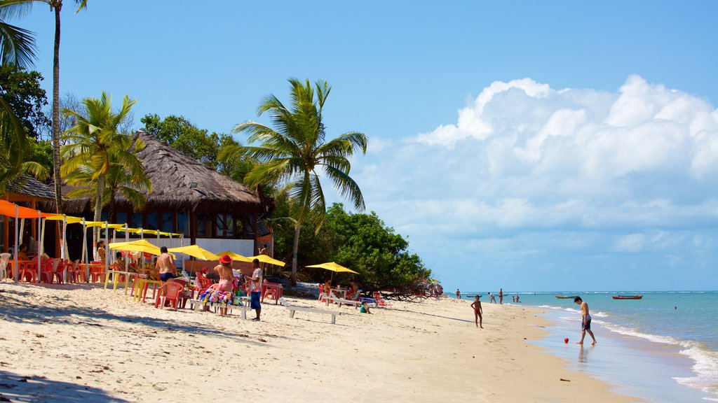 Muta Beach showing a sandy beach and general coastal views as well as a small group of people