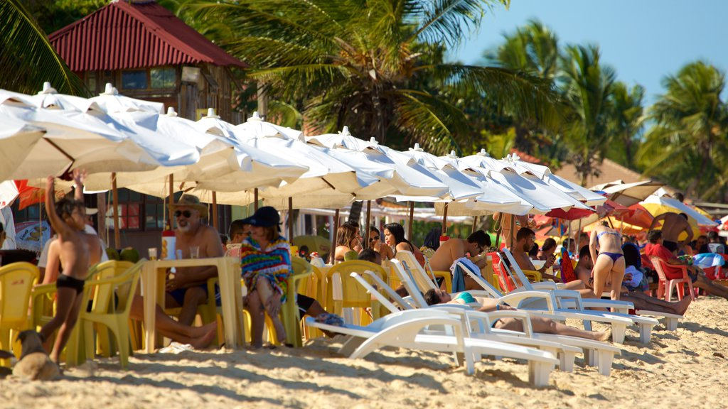 Taperapuan Beach showing outdoor eating, a luxury hotel or resort and general coastal views