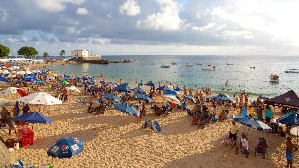 Praia do Porto da Barra caracterizando uma praia de areia, paisagens litorâneas e natação