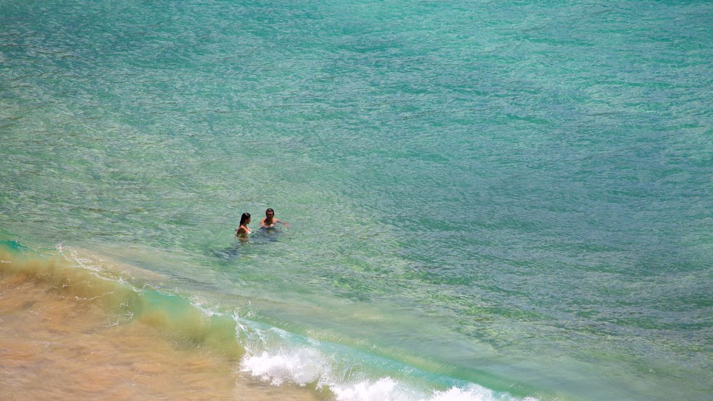 Sancho Beach which includes swimming, waves and general coastal views