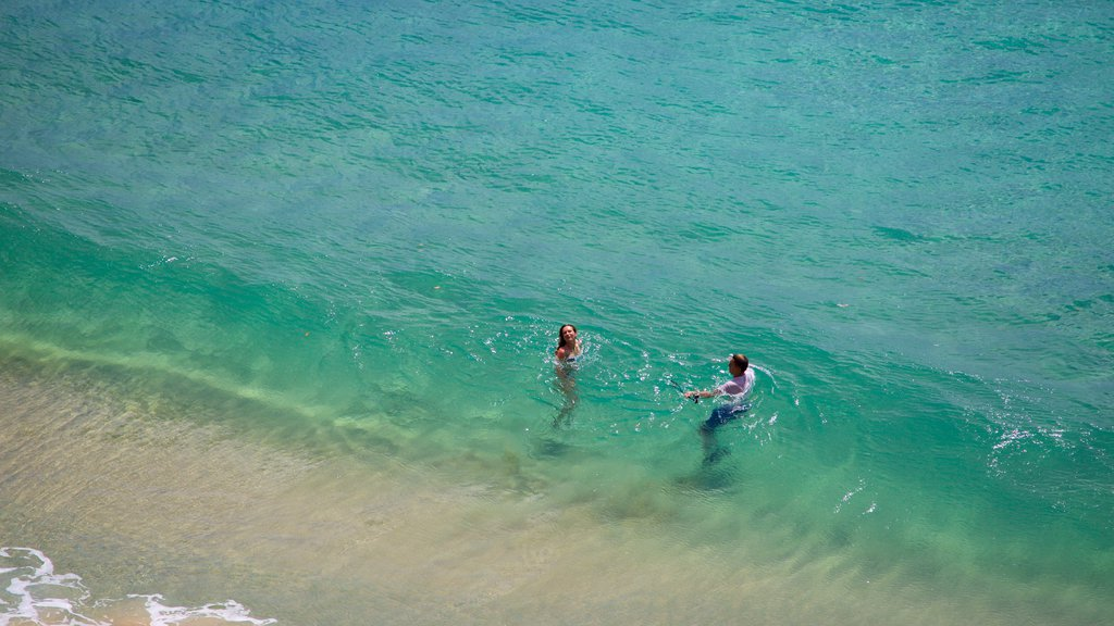 Sancho Beach featuring swimming and general coastal views as well as a couple