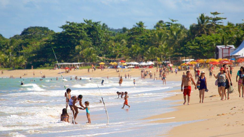 Taperapuan Beach which includes surf, a beach and general coastal views