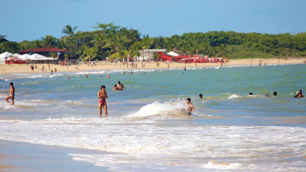 Taperapuan Beach featuring general coastal views, a sandy beach and surf