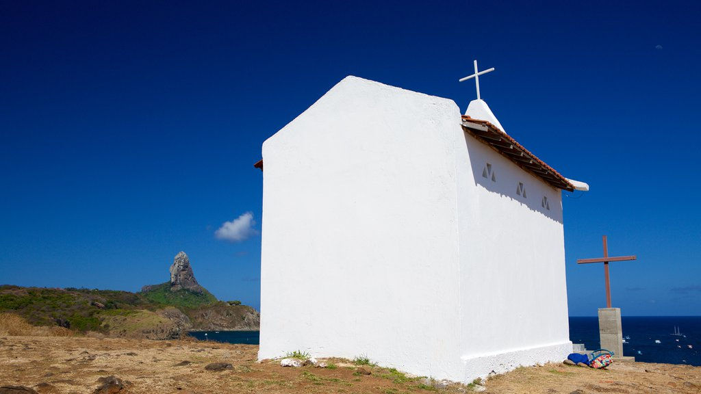 Sao Pedro Chapel featuring a church or cathedral, rugged coastline and religious aspects