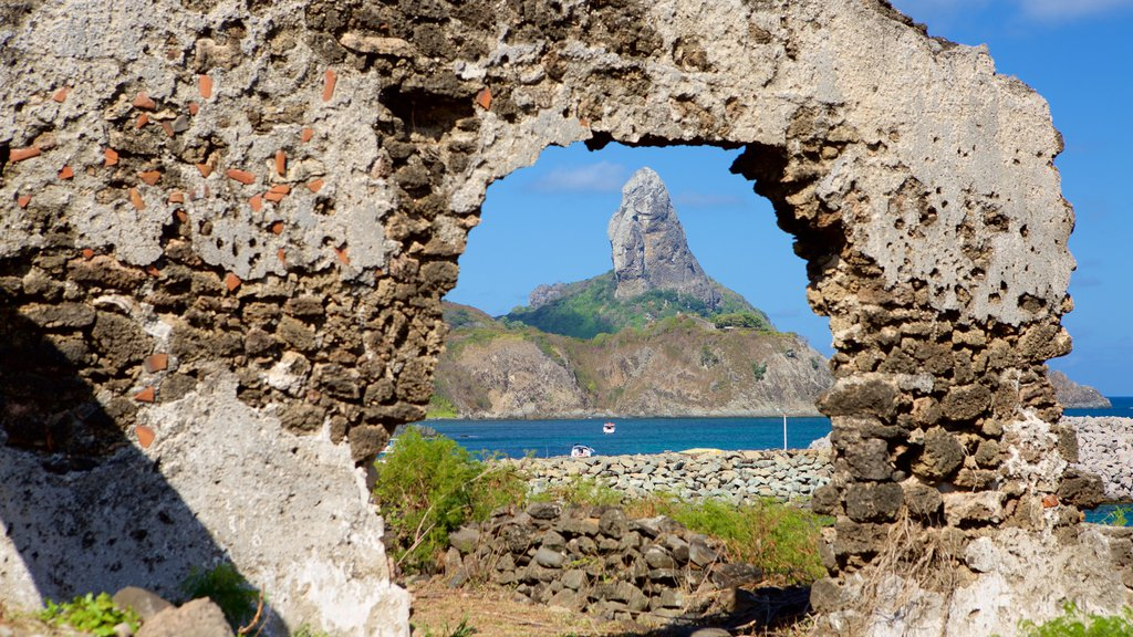 Santo Antonio Fort Ruins featuring mountains, a ruin and rugged coastline