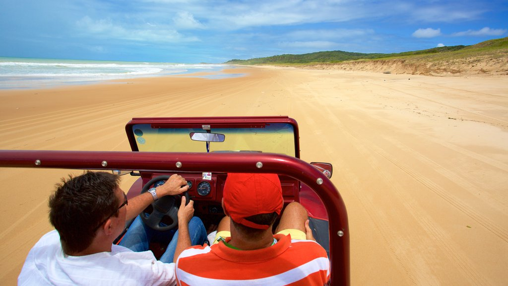 Natal which includes a beach, general coastal views and 4 wheel driving