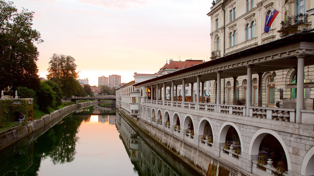 Ljubljana which includes heritage architecture, a sunset and a river or creek