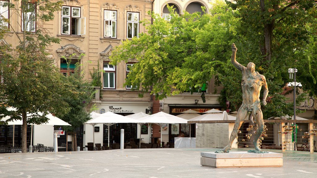 Ljubljana which includes cafe lifestyle, a square or plaza and a statue or sculpture