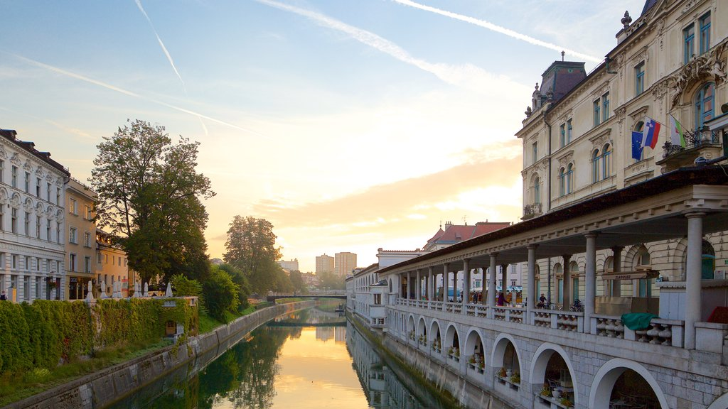 Ljubljana featuring a river or creek, a sunset and a city