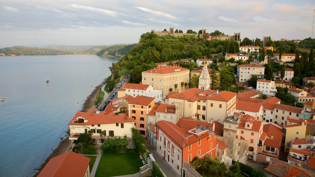 Piran which includes a river or creek and a city