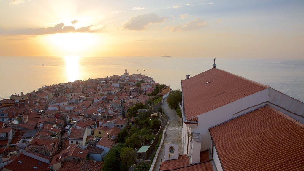 Piran featuring a coastal town and a sunset