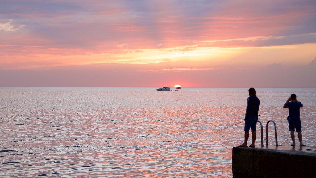 Piran showing fishing, general coastal views and a sunset