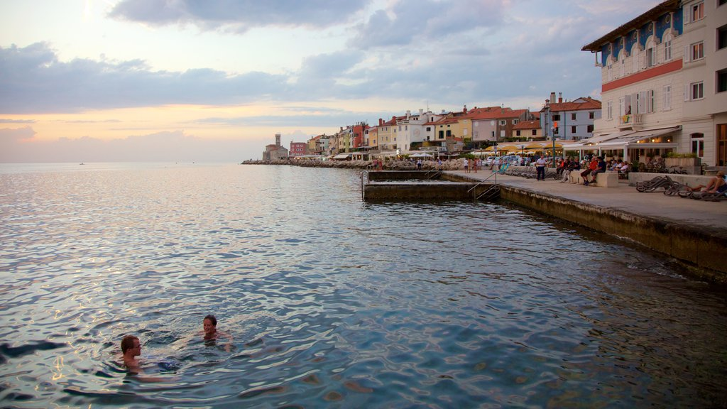 Piran which includes a coastal town, a sunset and general coastal views