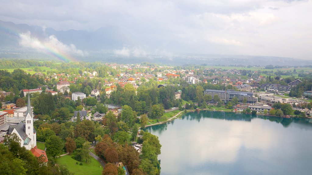 Bled showing a lake or waterhole and a small town or village