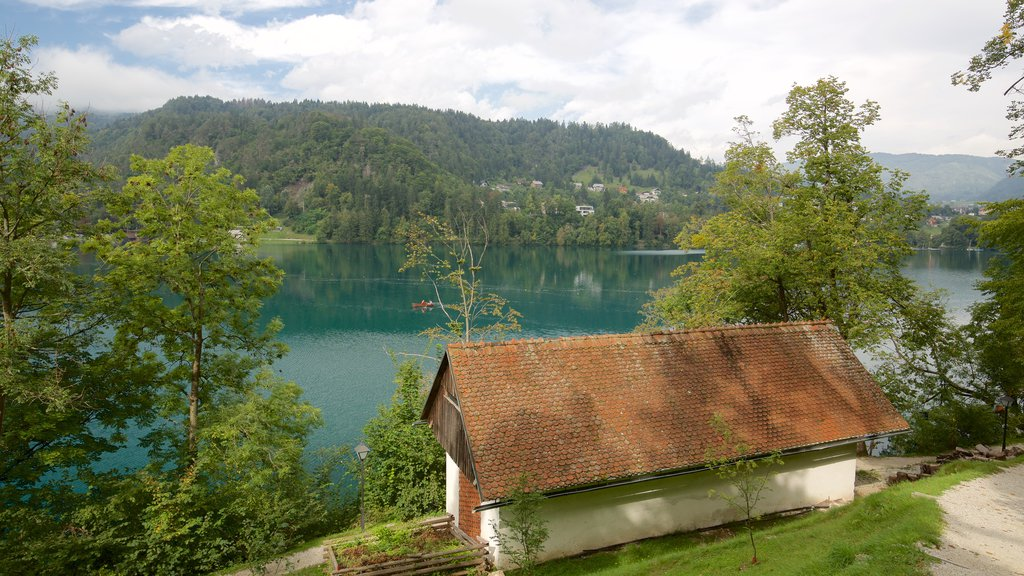 Church of Sv Marika Bozja which includes a lake or waterhole and a house