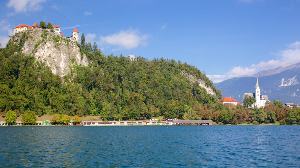 Lake Bled which includes a lake or waterhole and a castle