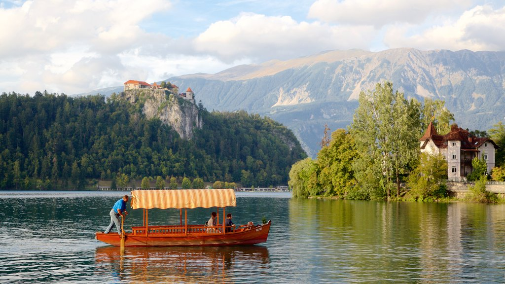 Lake Bled featuring a lake or waterhole, forest scenes and boating