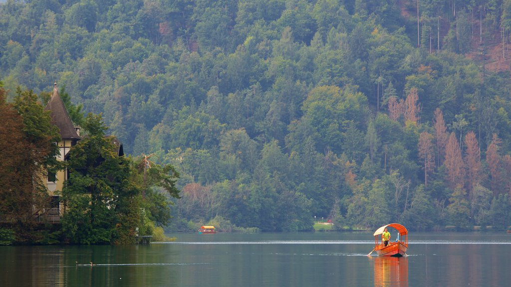 Lake Bled featuring forests, a lake or waterhole and boating