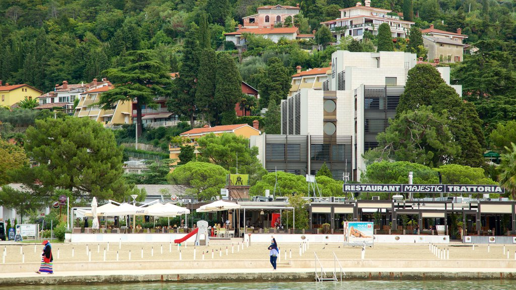 Portoroz Beach which includes outdoor eating and a coastal town
