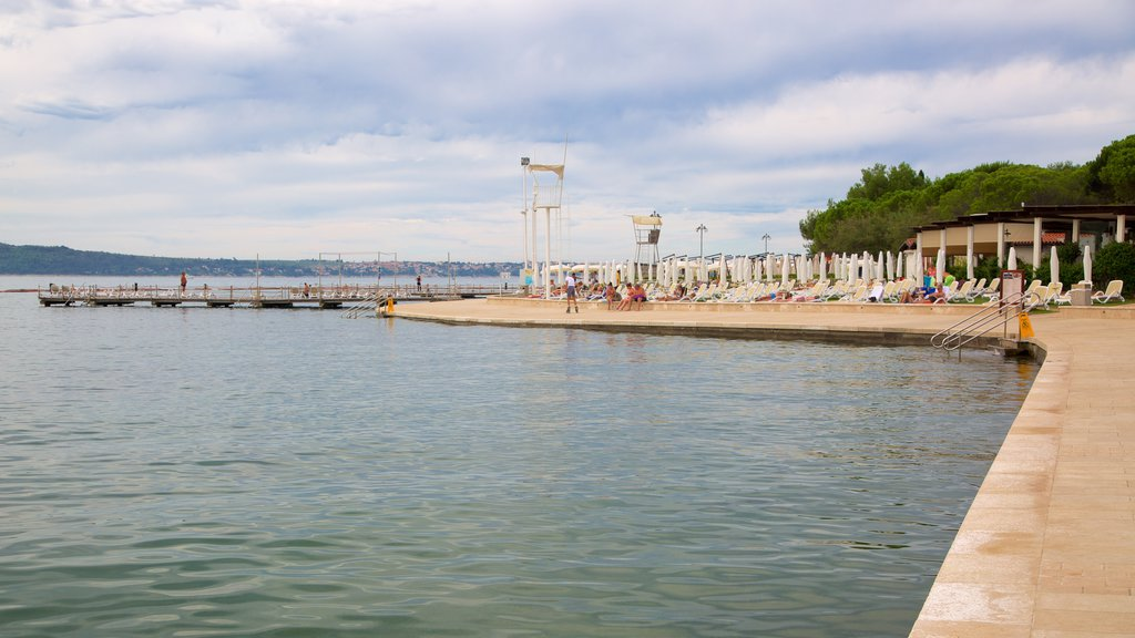 Portoroz Beach which includes general coastal views and a coastal town