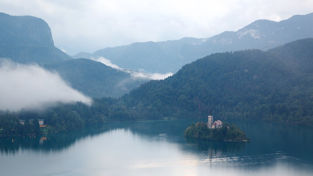 Church of Sv Marika Bozja showing mist or fog, a lake or waterhole and forests