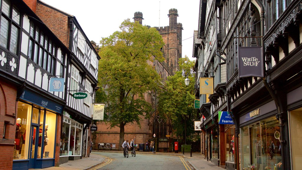 Chester Cathedral showing road cycling, a city and signage