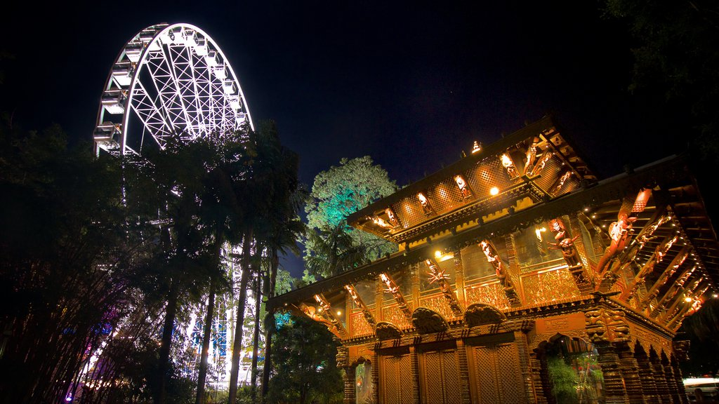 Southbank Parklands which includes modern architecture, night scenes and a temple or place of worship