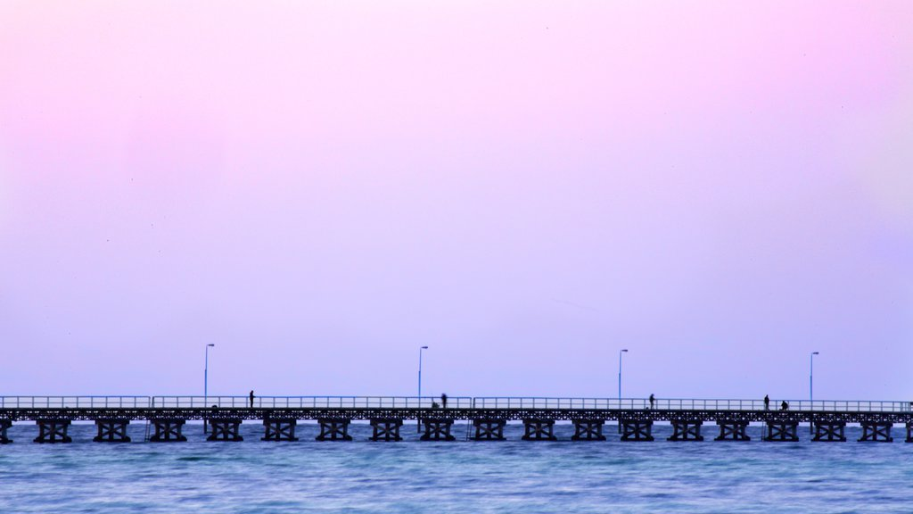 Busselton Jetty which includes a sunset and general coastal views