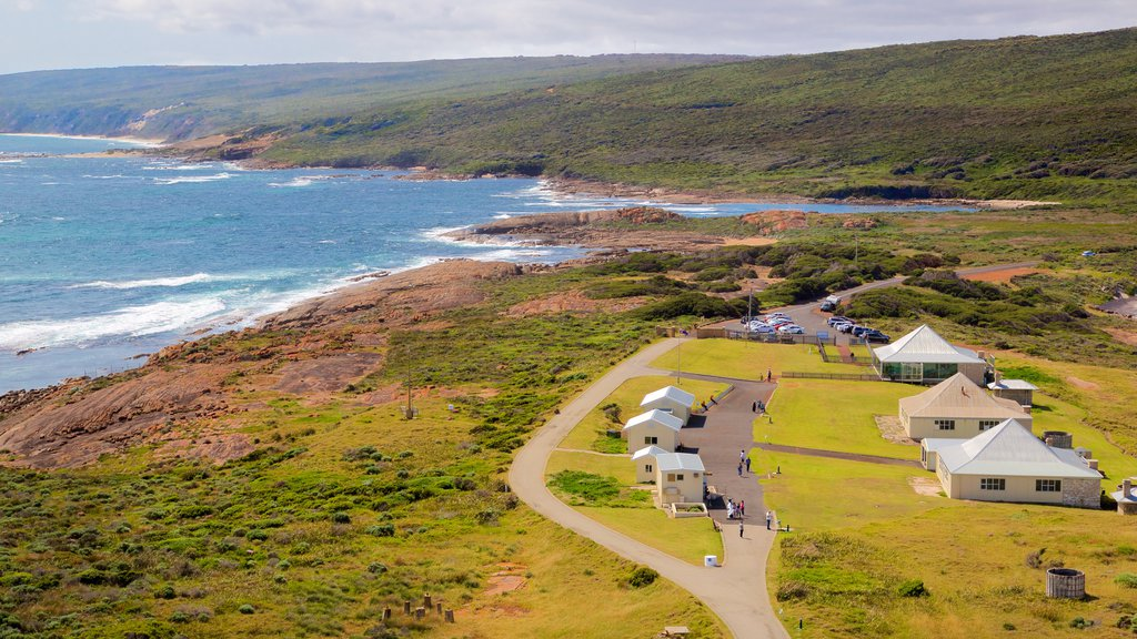 Cape Leeuwin Lighthouse which includes rugged coastline and a small town or village
