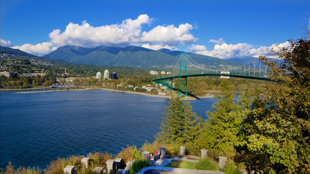Stanley Park which includes a bay or harbor, a bridge and mountains