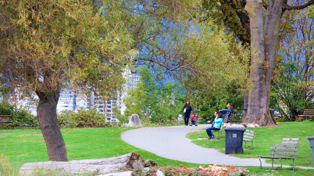 Kitsilano Beach showing a garden as well as a small group of people