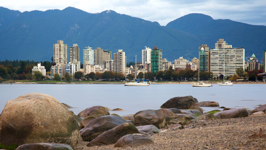Kitsilano Beach featuring a bay or harbor, mountains and a city