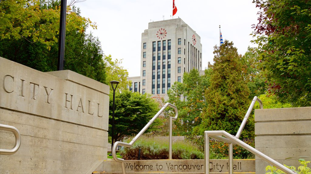 Vancouver showing a garden, signage and an administrative buidling