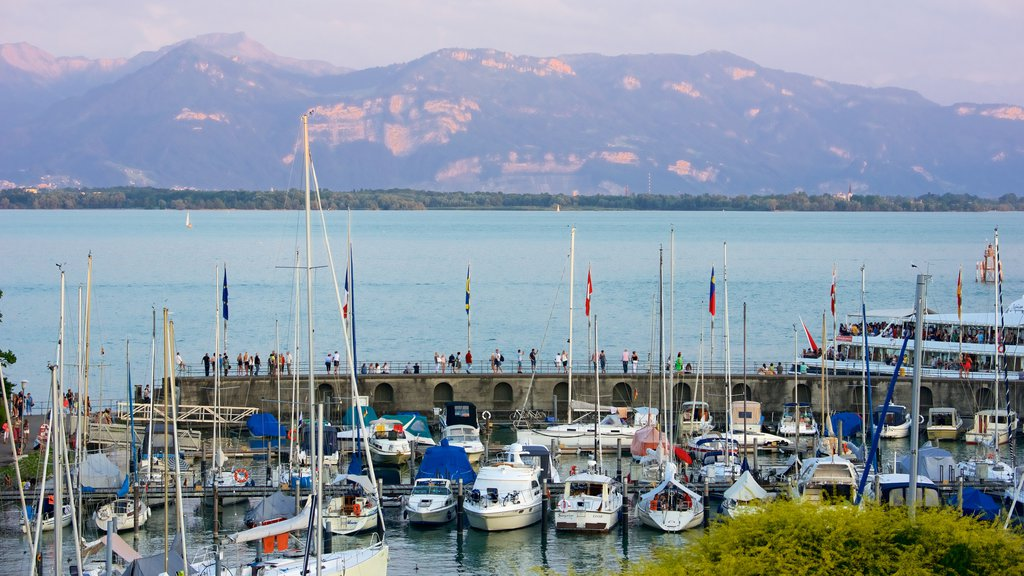 Lindau which includes mountains, a sunset and a bay or harbor