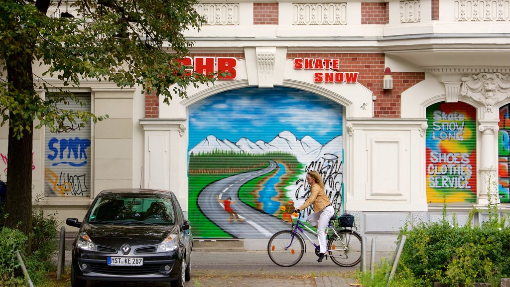 Berlin featuring street scenes, cycling and outdoor art